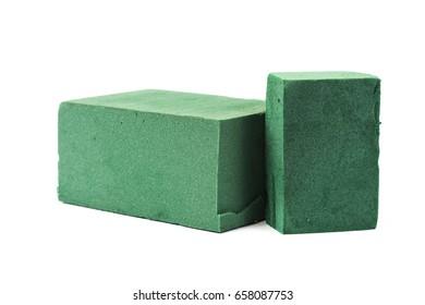 Green flora foam and gardener tool on white