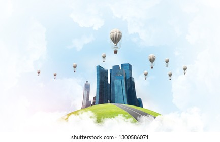 Green flying island among clouds with urban view of towers and skyscrapers. Flying aerostates and blue cloudy skyscape on background. 3D rendering.