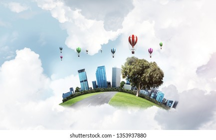 Green flying island with urban view of towers and skyscrapers. Flying aerostates and blue cloudy skyscape on background. 3D rendering.