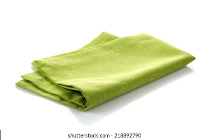 green folded cotton napkin isolated on a white background