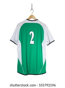 Green Football shirt number two  hanging on hook and isolated on white background
