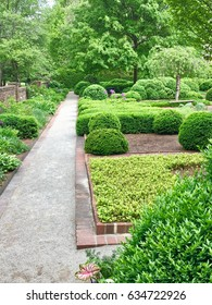 Green formal garden in park at springtime