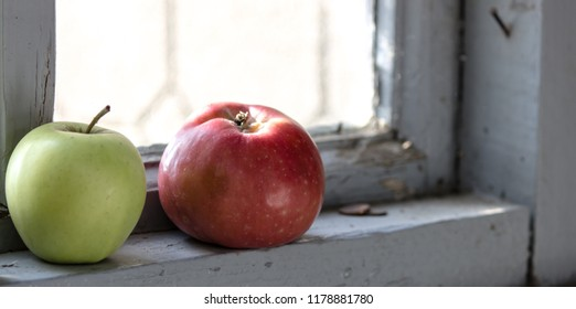 Green fresh apple on the white window sill. apples on an old window-sill