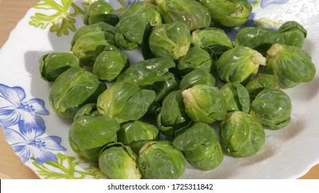 Green fresh brussel sprouts, top view, small cabbages, organic food, healthy diet