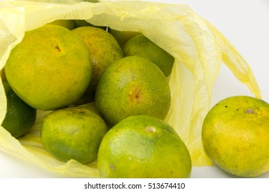 green fresh Citrus unshiu isolated on a white background