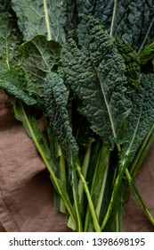 Green and fresh kale leaves, top view