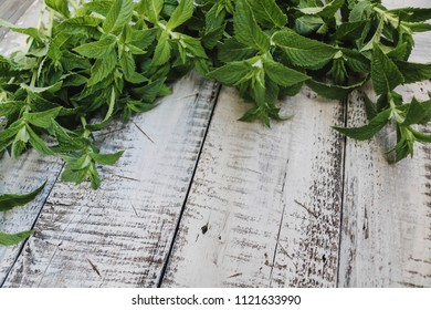 Green fresh mint om the wooden table