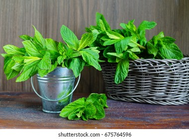 Green fresh mint on the wooden table - selective focus