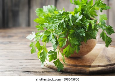 Green fresh parsley on the wooden table, selective focus