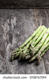 Green  fresh raw asparagus on rustic wooden table