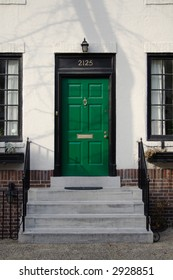 Green front door and steps.  Philadelphia, PA.