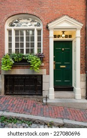 Green Front Door In White Portico Entryway with Side Window and Greenery