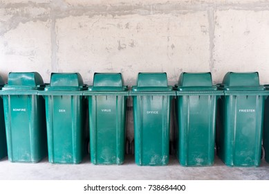 Green garbage containers in a front row.
