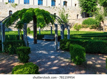 Green garden with geometric shades near Montepulciano Fortezza Medicea (Fortezza Di Montepulciano). Province of Siena, Tuscany, Italy.