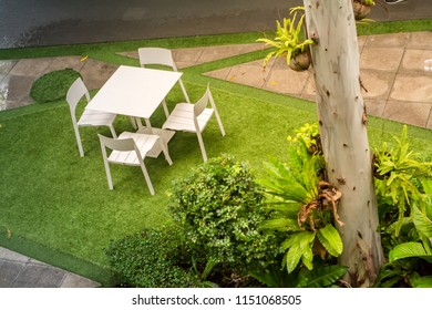 green Garden patio with table and chairs after raining