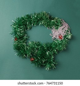 Green garland on green background. Minimal concept