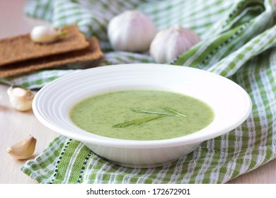 Green garlic cream soup with leaves rukola, arugula, healthy dietary vegetable dish