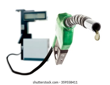 Green gas nozzle with one last drop of fuel and the station on white background