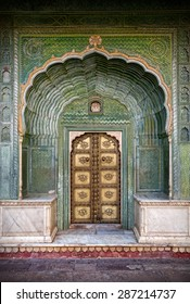 Green gate and golden door in City Palace of Jaipur, Rajasthan, India
