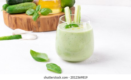 Green gazpacho with fresh cucumber, yogurt, herbs, garlic and olive oil served in glass. Spanish cold soup