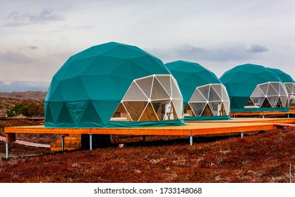 Green geo-dome tent on Kamchatka peninsula. Cozy, camping, glamping, holiday, vacation lifestyle concept. Outdoors cabin, scenic background - Shutterstock ID 1733148068