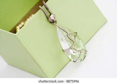 green gift box with diamond  necklace