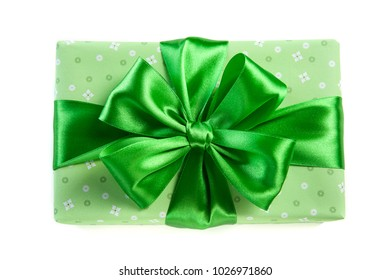 green gift box with satin bow  for Saint Patrick day isolated on white background