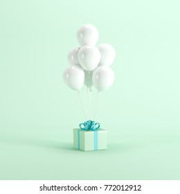 Green gift box with white balloon on green pastel background. minimal Christmas New year concept.