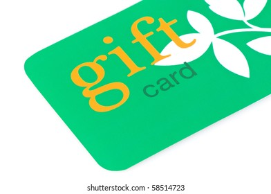 Green gift card with orange text and white leaves, great for environmentally friendly giving