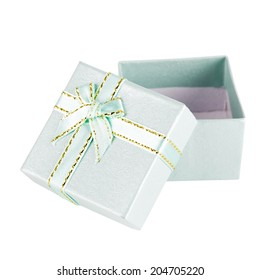 A green gift with a ribbon and a bow
