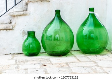 Green glass amphora on the outside of a farmhouse in Puglia, in southern Italy.