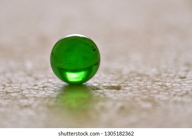 Green glass ball close up.