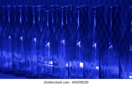 Green glass bottles for beverages, glass containers detail