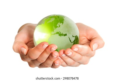 Green glass globe in hand isolated