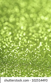 Green glitter with selective focus