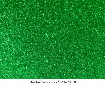 green glitter texture background. Selective focus.Shallow dof.