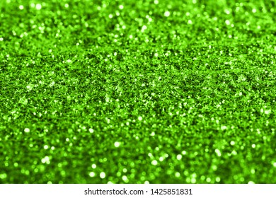 green glitter texture festive abstract background, Christmas background, workpiece for design, soft focus