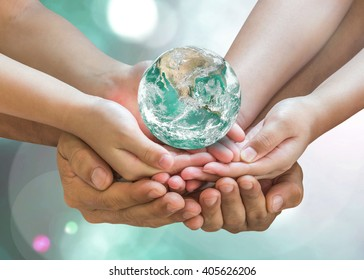 Green globe in family volunteer hands (father parent - children) for environmental protection, earth day, kindness charity donation, CSR with people concept. Elements of this image furnished by NASA.