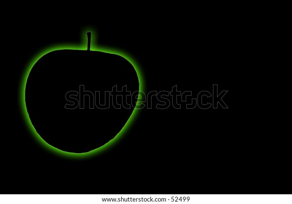 Green glowing apple on a black background