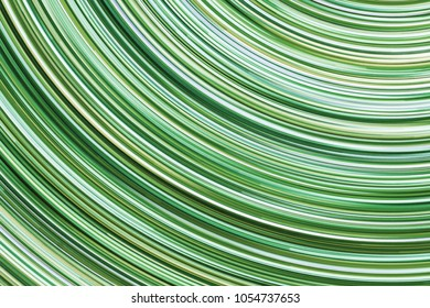 Green glowing lines. Abstract rotating circular shape pattern background.