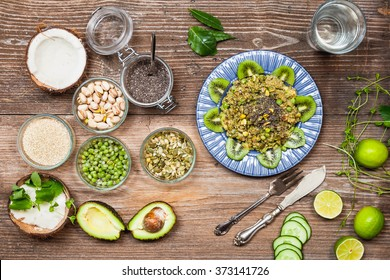 Green Goddess - Quinoa, Avocado, Peas and Pistachio Salad With Coriander Basil Pesto, Clean eating background. Healthy food and diet concept, top view, copy space