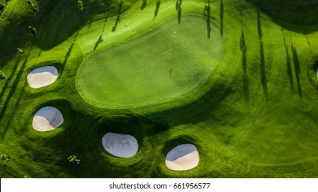 Green golf course, Aerial view putting green and beautiful turf golf course, Thailand.