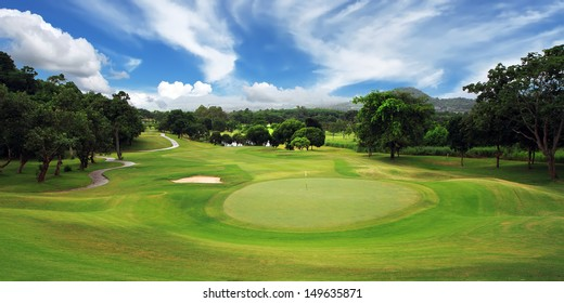 green golf course and blue sky