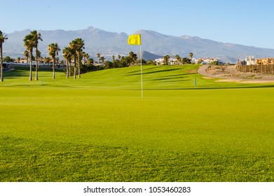 Green golf course facing the mountain and Teide volcano on the island of Tenerife in Spain