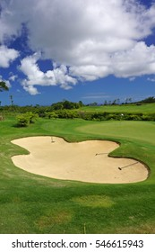 green golf course sand bunker with blue sky in summer