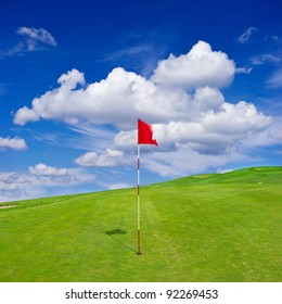 green golf field with cloudy sky. golf course background. beautiful nature landscape