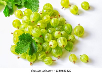 green gooseberry on white background close-up. background with gooseberry berries.