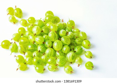 green gooseberry on white background close-up. ripe gooseberry berries on the table.