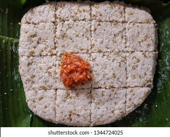 Green Gram Milk Rice (Mung Kiribath), a Sri Lankan Sinhala and Tamil New Year Festive Food, kept on a Banana Leaf