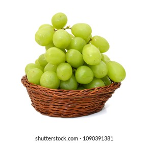 Green grape bunch isolated in basket on white background